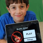 "Thomas Suarez is a 12-year-old Manhattan Beach kid who wrote an iPhone application called ""Bustin Jieber"" which is a game like whack-a-mole with a Justin Bieber face on it. Photo by Brad Graverson 10-20-11"