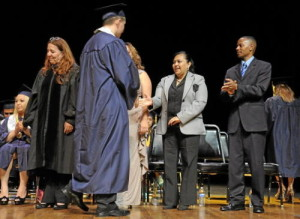 Dignitaries, including Mercedes Ibarra, center, congratulate graduates during commencement ceremonies for Lennox Math, Science & Technology Academy Teacher at El Camino College in Torrance, Calif., on June 8, 2013. (Jeff Gritchen / Staff Photographer)