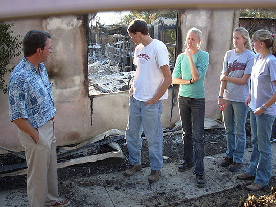 Westmont professor Russell Smelley is among 14 faculty families whose homes were destroyed in the Tea Fire. Despite the loss, he has drawn strength from daily fellowship with members of his Warriors cross-country team. (Rob Kuznia / Noozhawk photo)