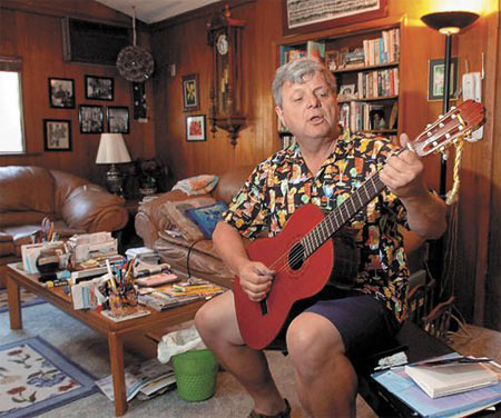 Les Benson, a teacher of 35 years, says he feels lucky to have bought his home on the Mesa in the 1970s for $54,000. Relaxing in his modest house, now worth $1 million, he plays a song he likes to sing with his students. STEVE MALONE/NEWS-PRESS PHOTOS
