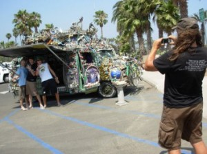 One Feather makes a living off donations from tourists who want their picture taken with his van. (Rob Kuznia / Noozhawk photo)