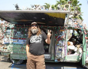 Hippie One Feather has turned his van, 'Temple of One Love,' into a one-of-a-kind piece of art with thousands of figurines, instruments and other items. (Rob Kuznia / Noozhawk photo)