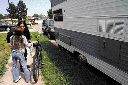 Marina needs do some errands, but because the RV doesn't run very well her only viable mode of transportation is a bicycle. Her husband is at work. Ernie Rodriguez offers to give Elizabeth a lift a few miles away so she can be watched by a trusted friend.